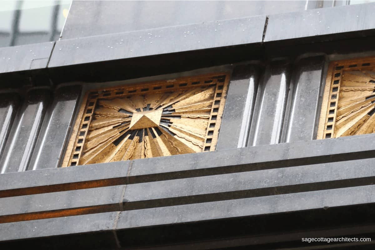 Gold plated Art Deco sunburst panel in dark grey terra cotta panel