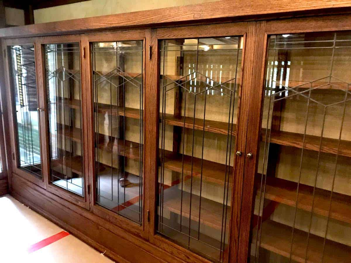 Prairie stye oak book cases with glass fronts.