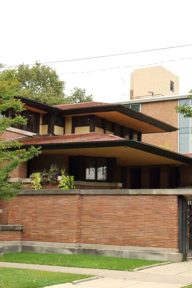 Low sloped red roofs and brick garden wall of the Robie House.
