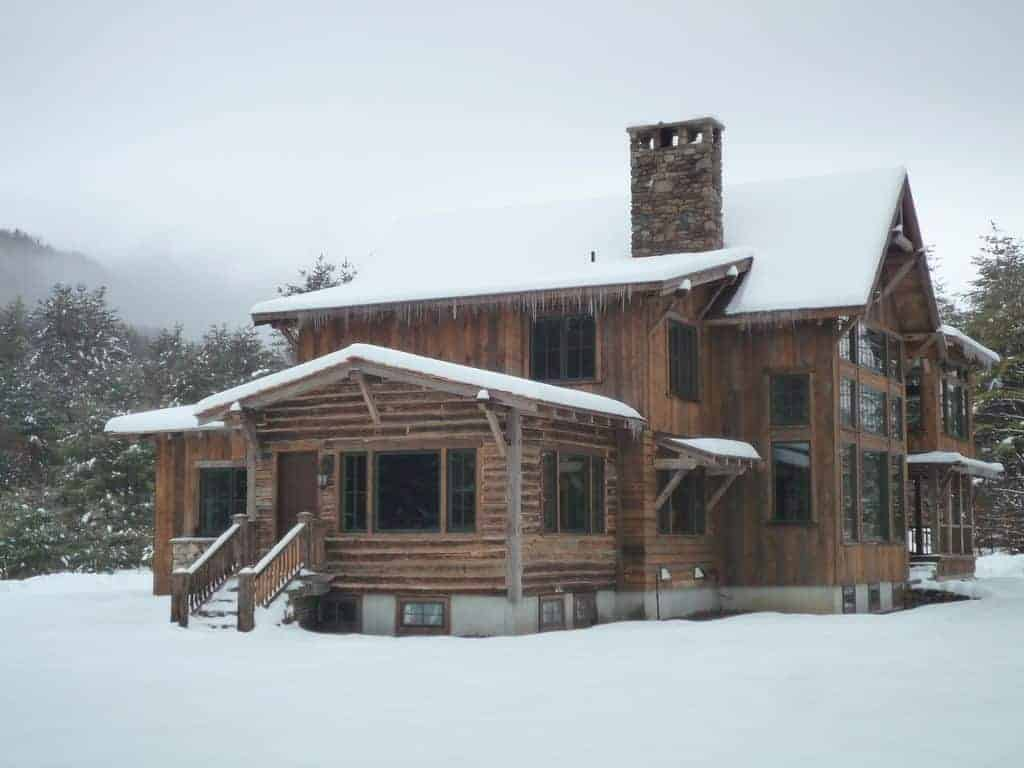 Exterior photo of a ski vacation home rental in the snow.