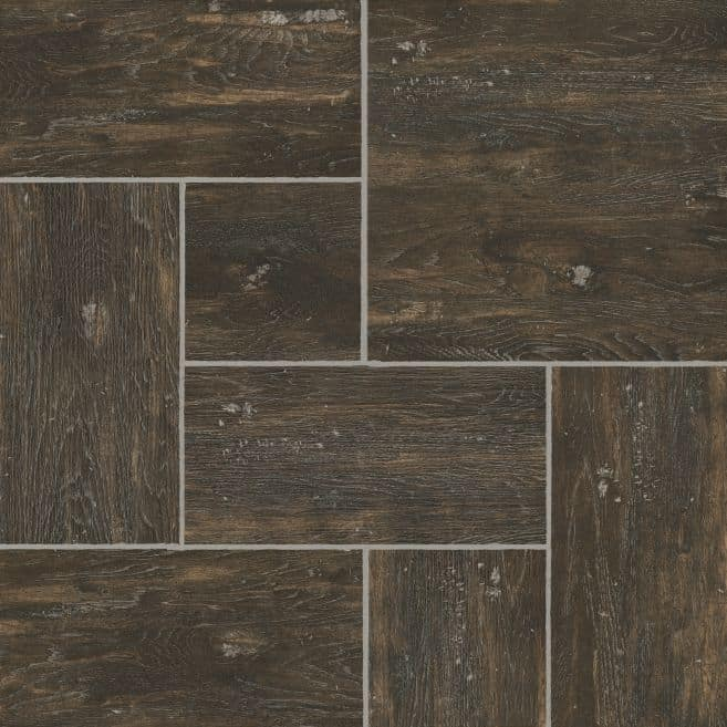 Photo of dark brown luxury vinyl tile floor sample