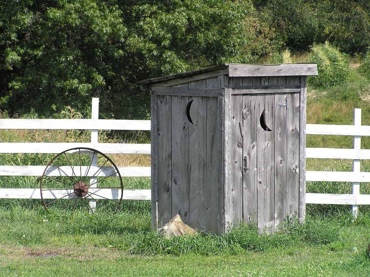 Photo of early septic systems - a rustic outhouse.