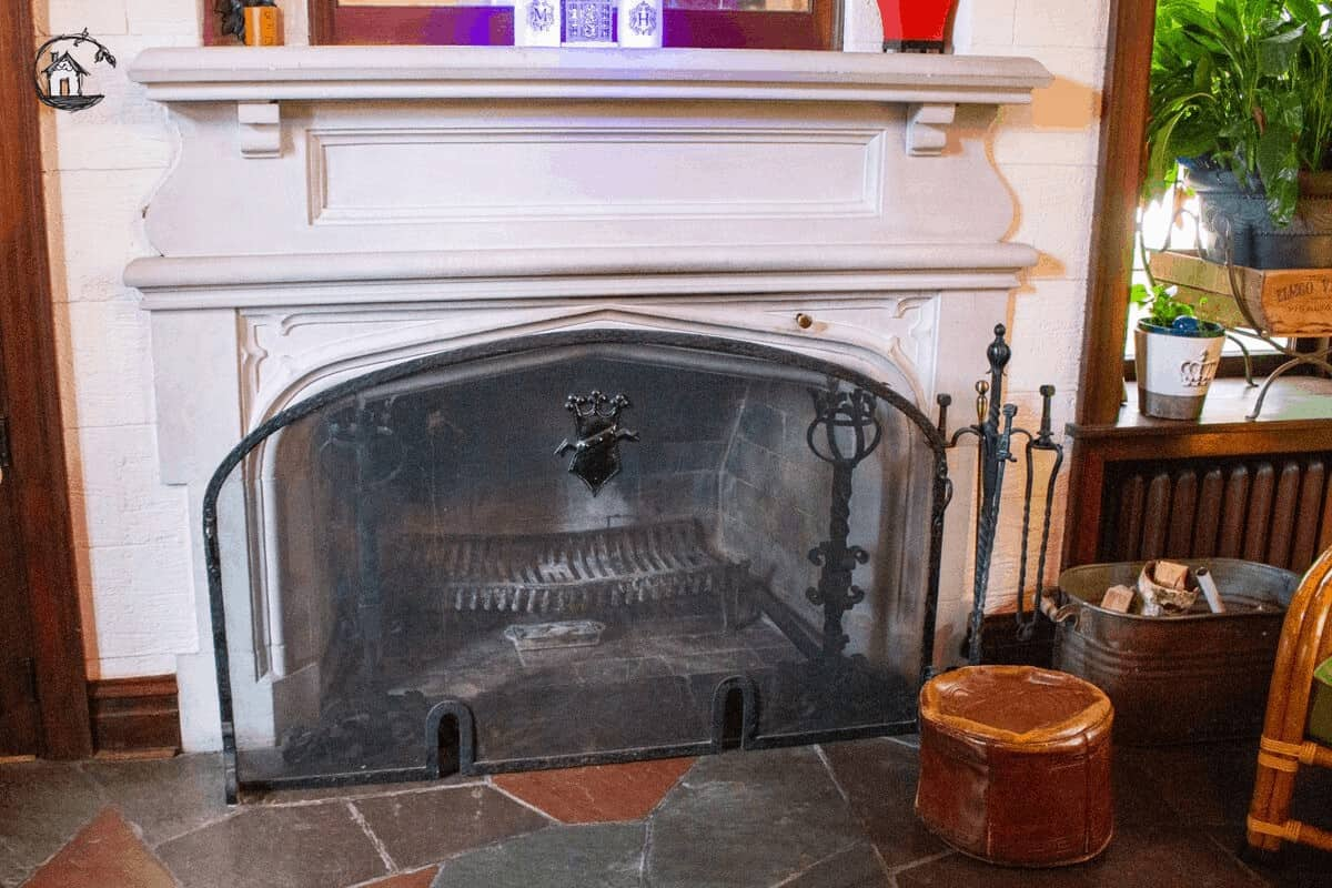 Photo of a white fireplace with trim work, seen on the old house tour.