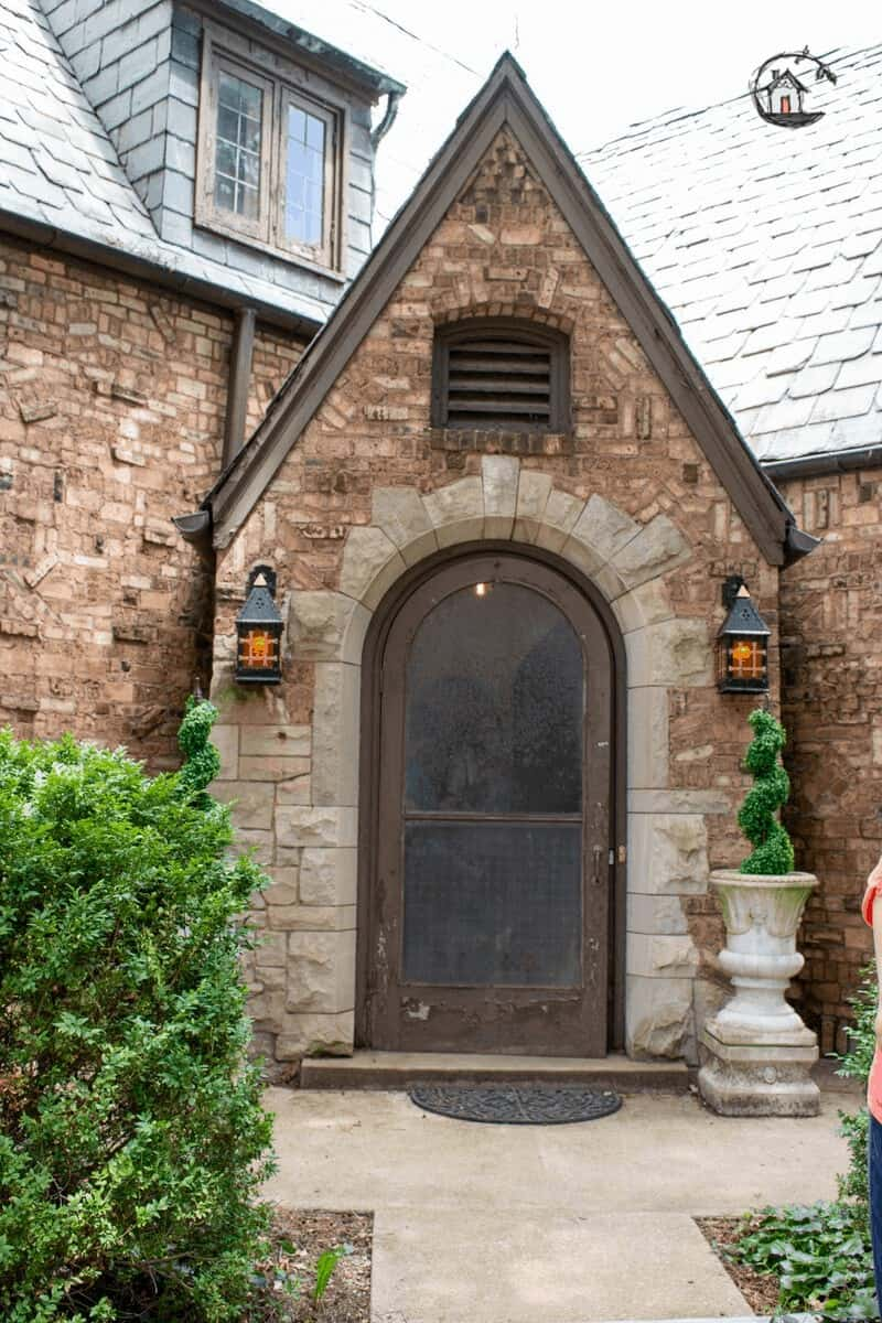 Photo of old house brick entry with Gothic elements.