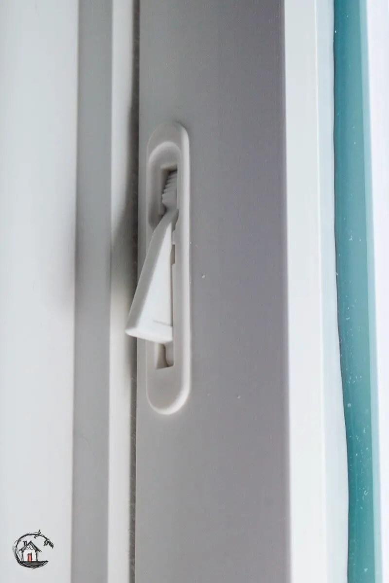 Photo of vinyl replacement window vent latch.