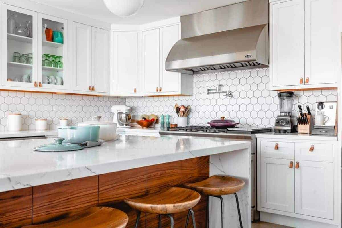 Photo of white kitchen with large island.