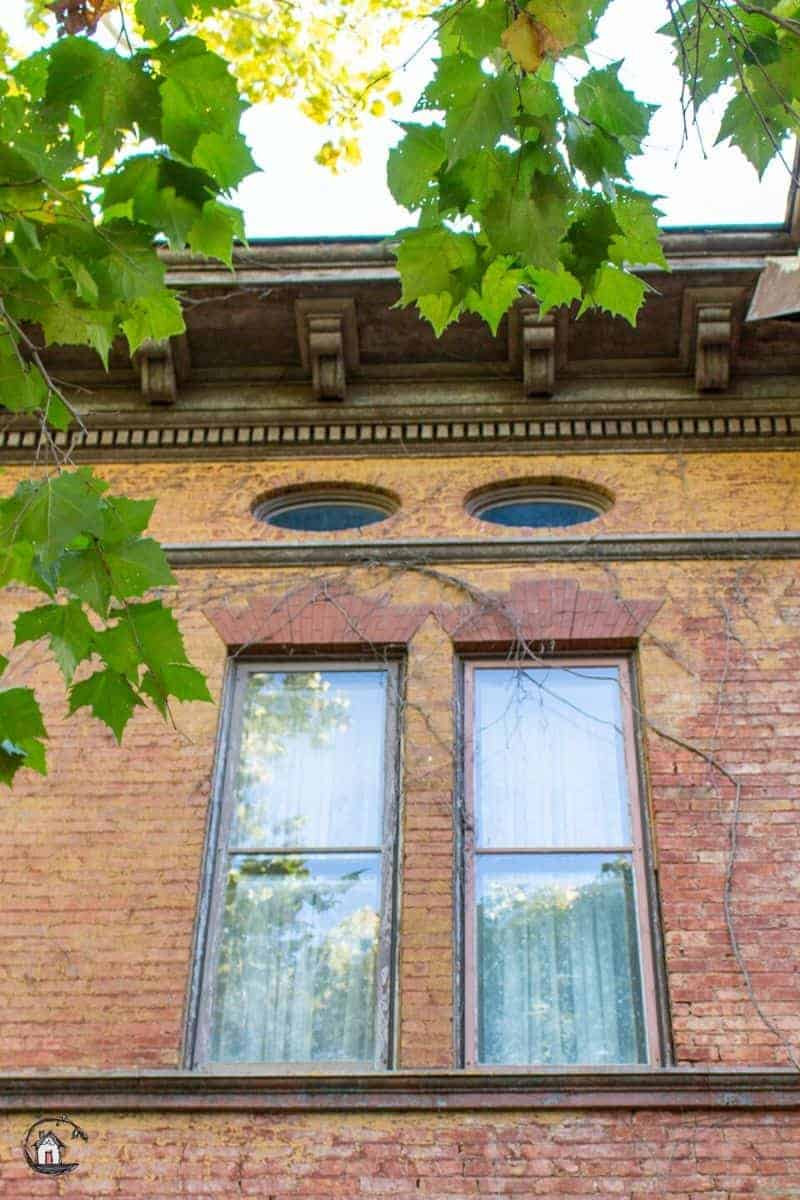 Photo of two small lozenge shaped windows on the Vrooman Mansion.