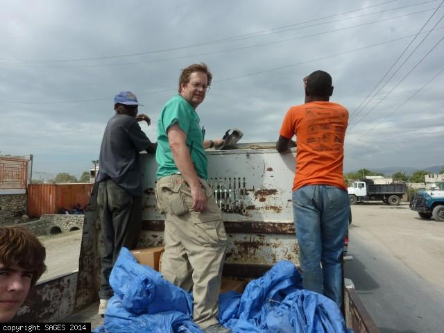 Riding in truck distributing supplies Haiti