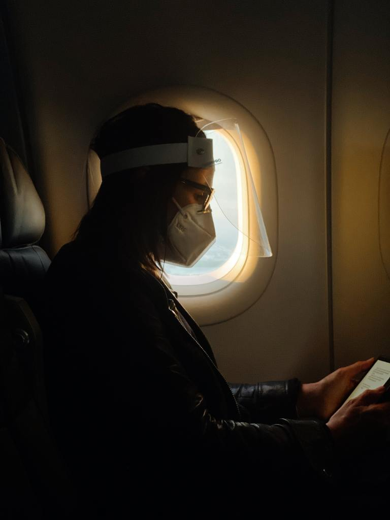 Passenger wearing mask in a plane
