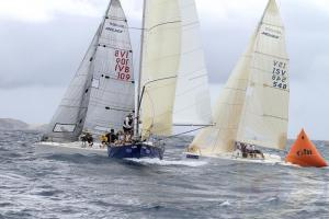 Rounding the Windward and Offset Mark with a Symmetrical Spinnaker