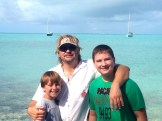 Boys with Boat Anchored behind.