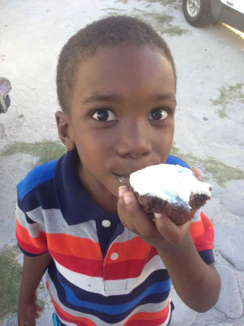 Local Bahamian boy enjoying Roxane's Muffins