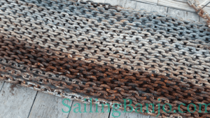 Anchor chain with rusty trouble areas (darker color)