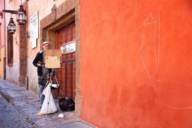 A painter takes advantage of a beautiful early morning light before the chaos of the Festival takes over the streets