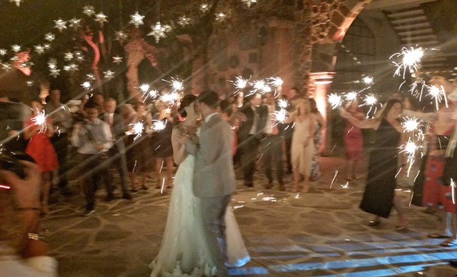 First dance lit by sparklers.