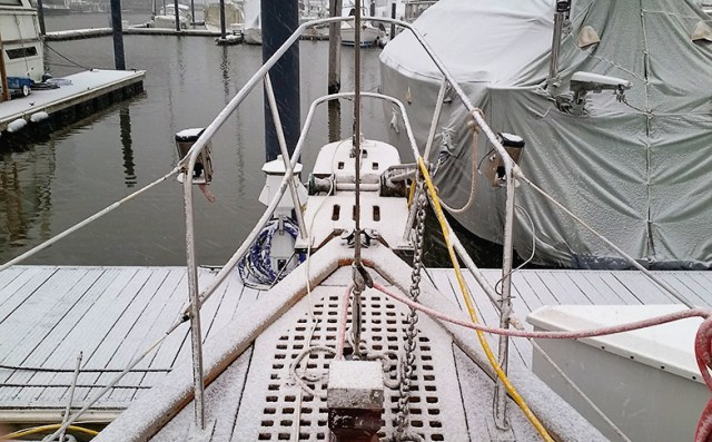A coating of snow covers the bow of our Vagabond 42.