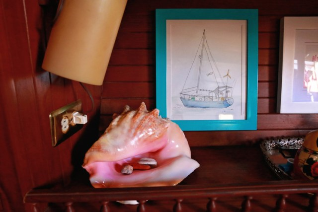 A conch shell we caught in the Bahamas and a custom watercolor of Chance, our 34' Seafarer, by my talented friend Alison