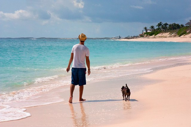 walking along the pink sand beach in Hope Town on Elbow Cay, Bahamas