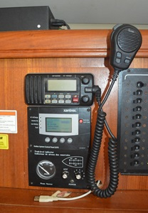 The VHF radio next to the electric panels.