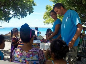 Cruisers provide glasses to people on Likiep Atoll.