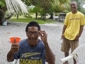Thumbs up from an elderly gentleman on an outer island in the Marshall Islands.