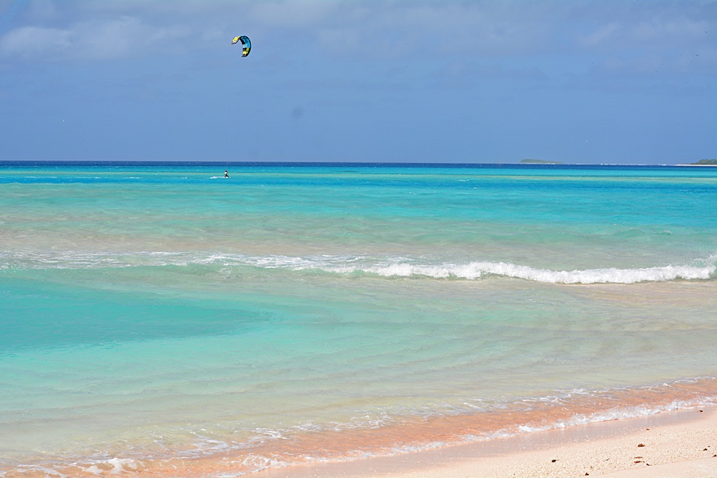 Grant Gardner kite boarding in Rongerik. Photo: Carley Shelton on S/V Viandante