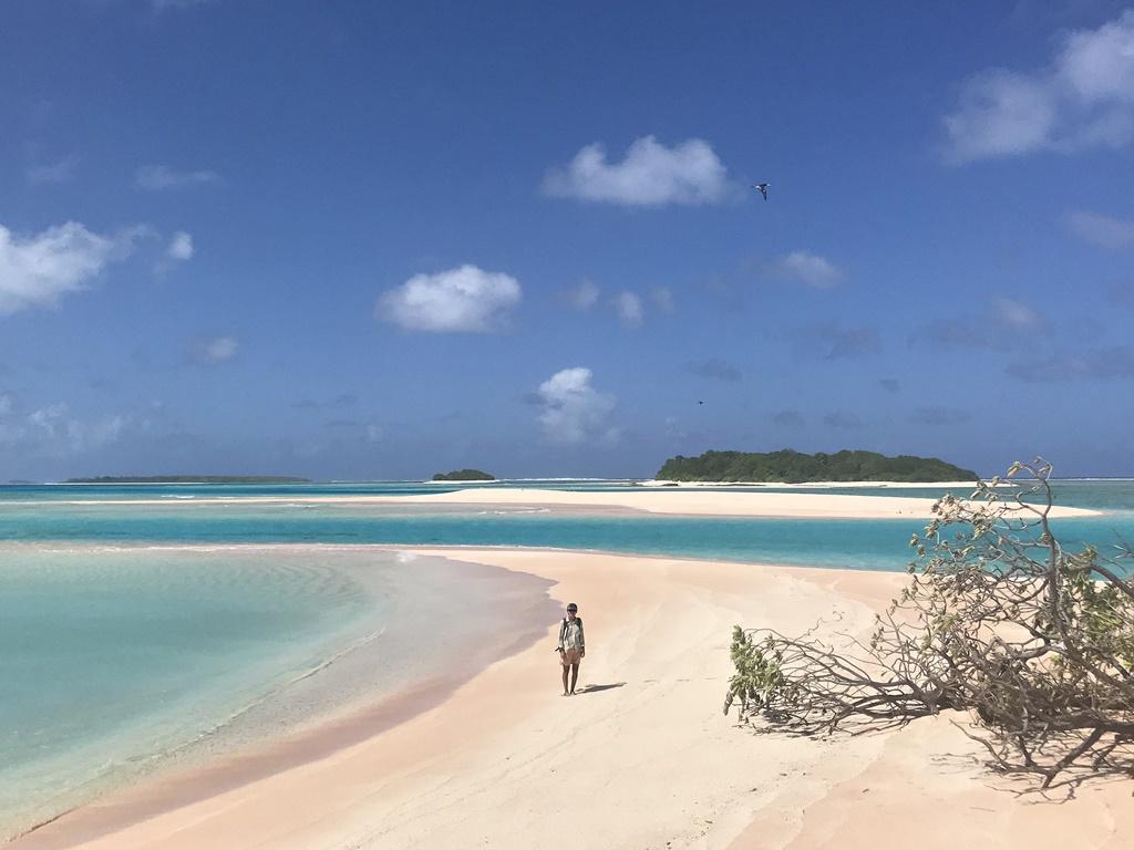 Carley Shelton on one of Rongerik's gloious beaches. Photo: Grant Gardner of SV Viandante.