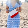 model carrying red wristlet
