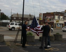 Lowering the old, worn out flag