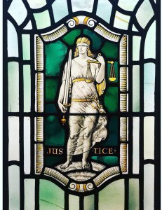 Stained glass in Freemasons Hall, London depicting Justice, one of the Four Cardinal Virtues: Prudence. Temperance. Fortitude and Justice (photo courtesy of United Grand Lodge of England)