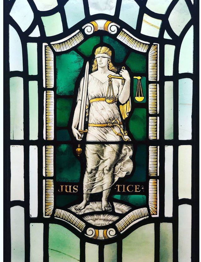 United Grand Lodge of England stained glass window depicting Justice, one of the Four Cardinal Virtues (Courtesy of United Grand Lodge of England)
