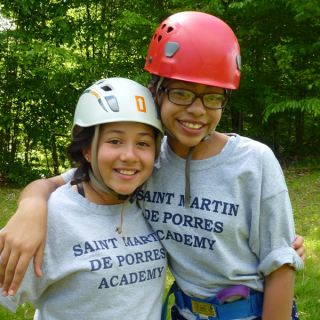 Saint Martin de Porres Academy students challenged themselves and each other through team building activities at a 3-day school-wide camping trip to the Berkshire Outdoor Center in Becket, MA.