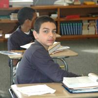 Student William Cotto at desk