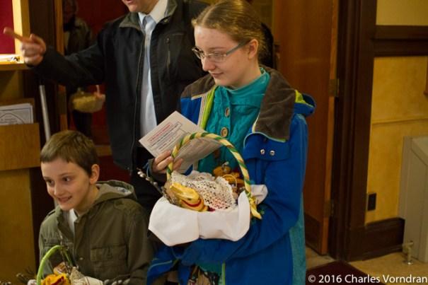 Children bringing food baskets
