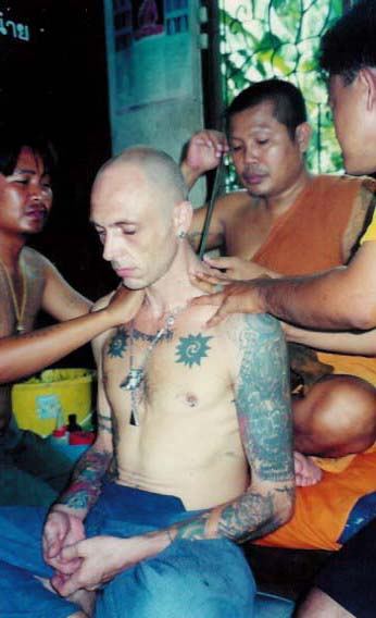 Ajarn Spencer Littlewood gets Yant Gao Yord from Luang Pi Pant at Wat Bang Pra in 1997