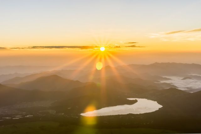 61923526 - sunrise view from summit of the mount fuji