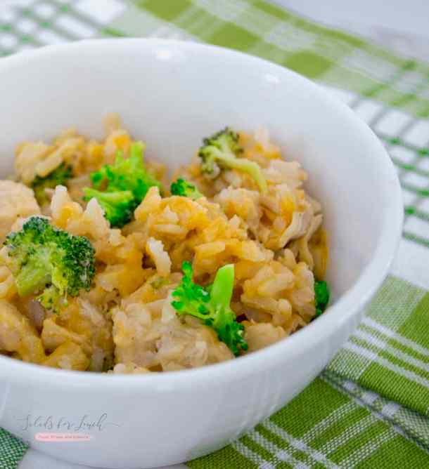 Instant Pot Chicken and Broccoli Cheesy Rice Casserole close up in a white bowl