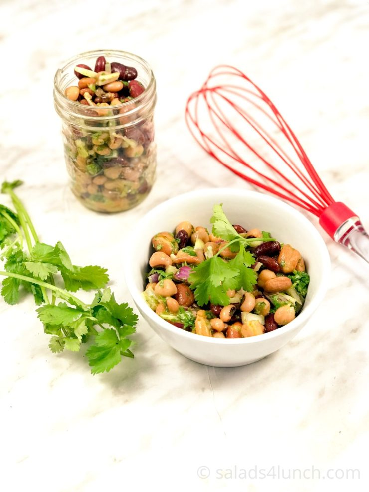 bean salad with whisk