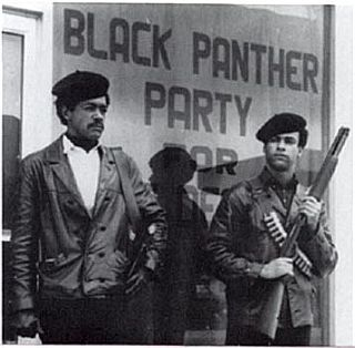 1960s photo of Black Panther founder Huey Newton, right, with Black Panther Party co-founder Bobby Seale.