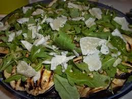 La chef consiglia: parmigiana di melanzane con grana e rucola