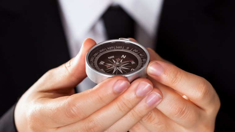 Man Holding Compass - How to Close a Sale