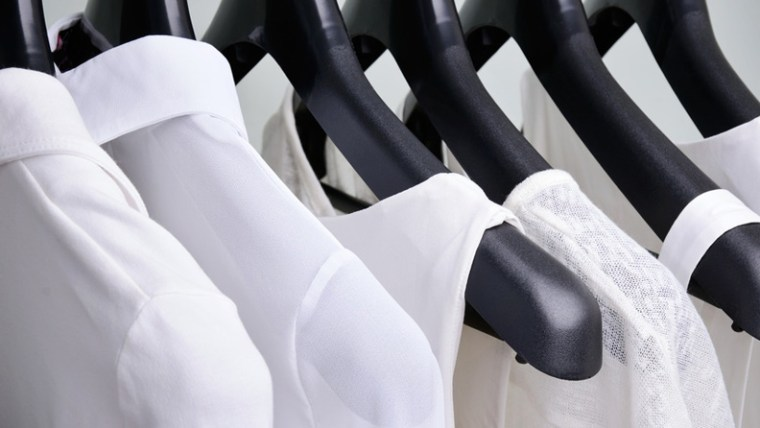 White shirts hanging in a closet simplify your workday by creating no-brainer decisions