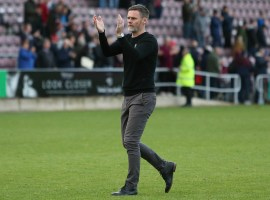Graham Alexander applauds the away support after Northampton test. (Credit: Salford City - Charlotte Tattersall)