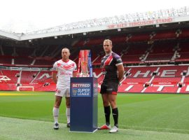 Salford Red Devils captain Lee Mossop poses with the Super League trophy. Credit: Salford Red Devils