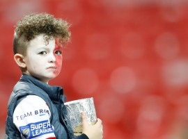 Image Credit: PA Images. A St Helens fan in the stands