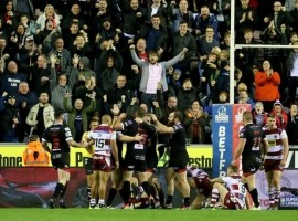 Salford Reds Joey Lussick is congratulated after scoring during the Betfred Super League semi final match at the DW Stadium, Wigan.