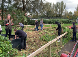 Young volunteers of the Prince's Trust clearing the land