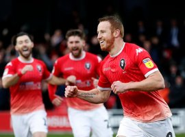 Salford City's Adam Rooney celebrates scoring his side's first goal of the game
