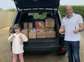 Dan Williams and his daughter with donations for Emmaus Salford.  Photo came with press release email.