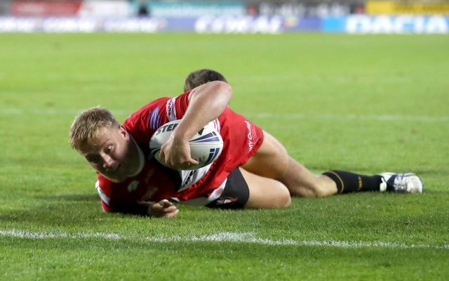 Salford Red Devils' James Greenwood dives in to score a try during the Betfred Super League match at Totally Wicked Stadium, St Helens.